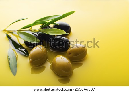 Olive fruit in oil background close up