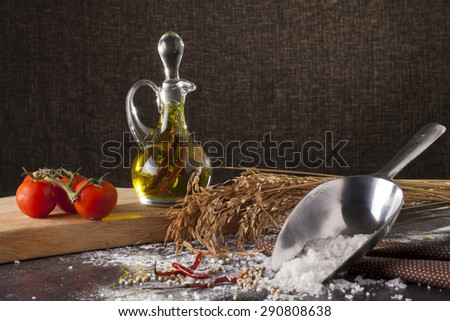 olive oil an isolate bottles of olive oil in decorated scene - stock photo