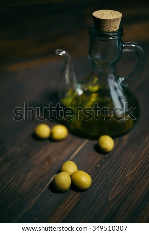 olive oil and olives on the wooden table