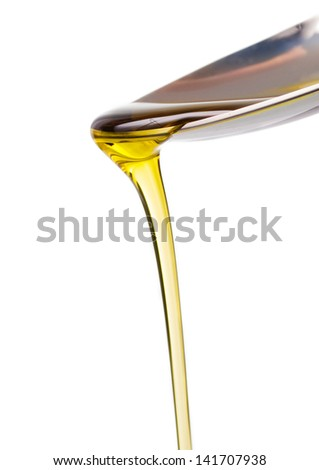 Olive oil and spoon isolated on white background - stock photo