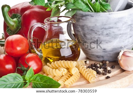 Olive oil and vegetables. Close up shot. - stock photo
