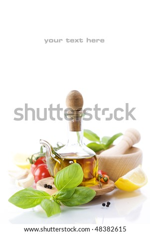 olive oil, basil and vegetables over white (with sample text) - stock photo