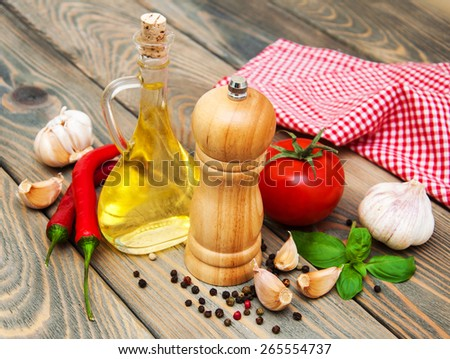olive oil,  basil, tomato and garlic on a wooden background
