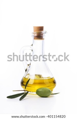 Olive oil bottle and fresh olive isolated over white background - stock photo