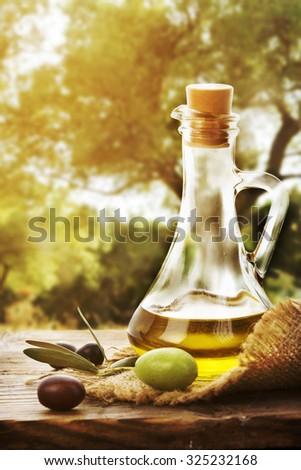 Olive oil bottle and olive fruit - stock photo