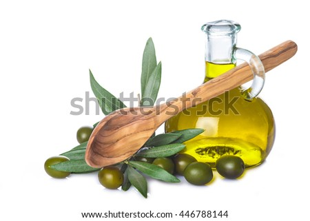 Olive oil bottle and wooden spoon with leaves and olives isolated on a white background - stock photo