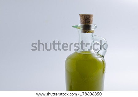 Olive oil bottle on isolated on gray blue background