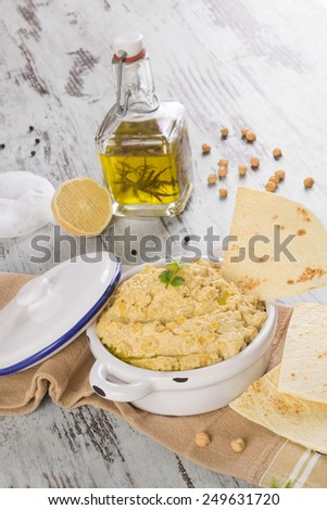 Olive oil, hummus, chickpeas and pepper corns isolated on white background. Culinary mediterranean cuisine.  - stock photo