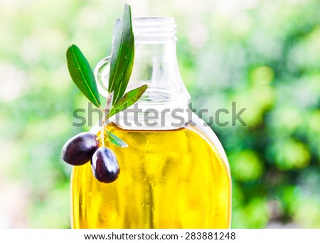 Olive oil in a bottle - stock photo