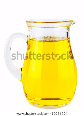 olive oil in glass jar over white background