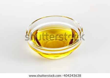 olive oil in glass plate closeup on white background