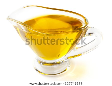 Olive oil in gravy boat, isolated  on white background - stock photo
