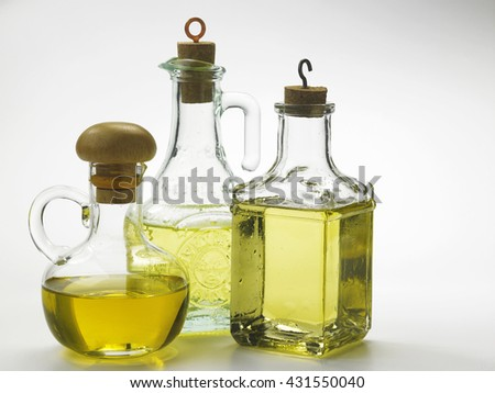olive oil in the bottle on the white background - stock photo