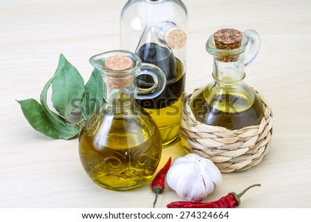 Olive oil in the bottles with laurel leaves - stock photo