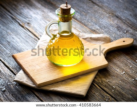 Olive oil on vintage  wooden table - stock photo