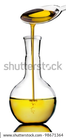 Olive oil poured into a bottle on white - stock photo