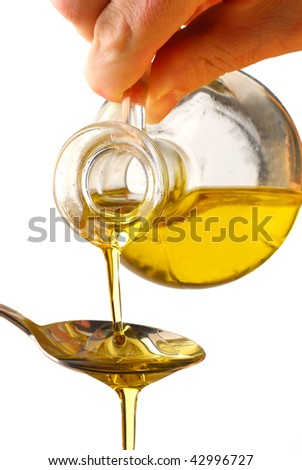 Olive oil poured into a spoon isolated on white background - stock photo