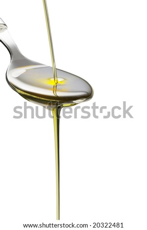 olive oil poured on a spoon over white background - stock photo