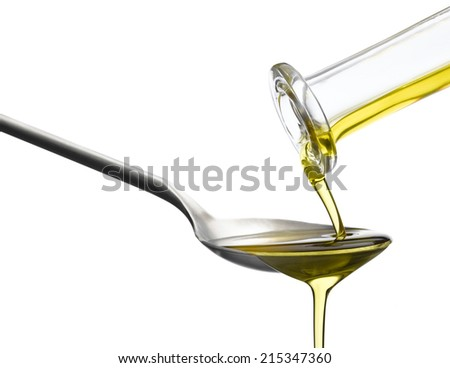 Olive Oil pouring onto spoon