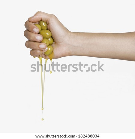 Olive oil pouring out. Pouring olive oil. Olive oil.Olive oil concept. - stock photo