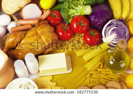 Olive oil, vegetables, bread, oil, macaroni and chicken meat - stock photo