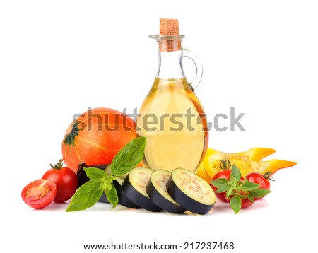 Olive oil with fresh pumpkin, eggplant and tomatoes on white background - stock photo