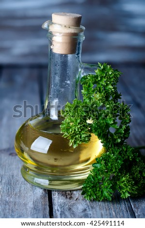 Olive oil with herbs and pepper in the jar - stock photo