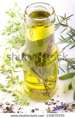 olive oil with herbs in a bottle
