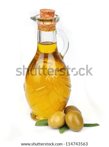 Olive oil with olives on white close up
