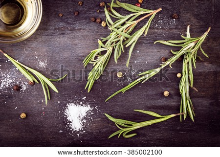 Olive oil with  rosemary, pepper and salt. Mediterranean ingredients. - stock photo