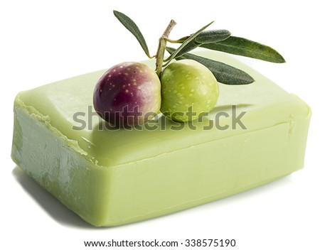 Olive's branch on natural olive oil soap isolated on white background. - stock photo