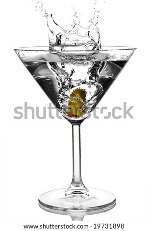 Olive splashing on martini isolated on white stock photo