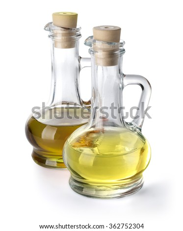 olive vegetable oil in glass pitchers isolated on white with clipping path included