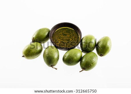 olive with oil in a wooden bowl isolated on white background - stock photo
