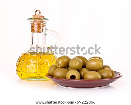 Olives and a bottle of oil isolated on white - stock photo