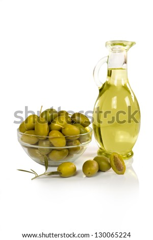 olives and a bottle of olive oil isolated on white - stock photo