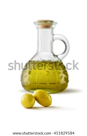 Olives and bottle of virgin olive oil on white background - stock photo