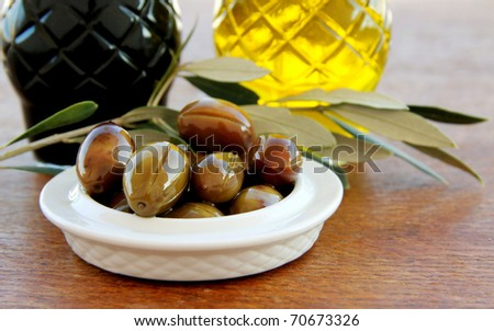 Olives and Olive Oil,balsamic vinegar on a wooden table - stock photo