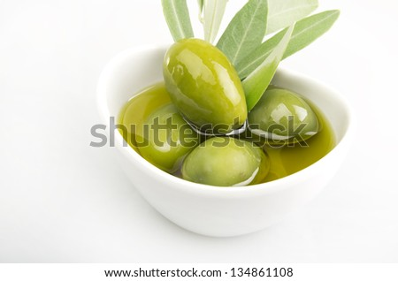 Olives and Olive Oil close up on white - stock photo