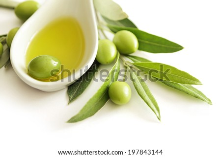 olives and olive oil on white background - stock photo