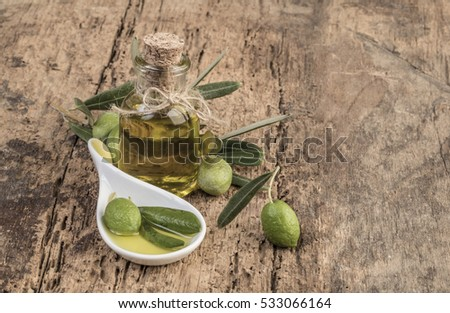 olives and olive oil on wooden table