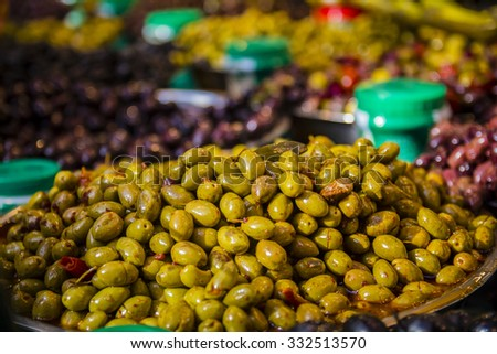 Olives at a market stall.  - stock photo