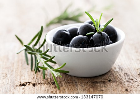 olives black with rosemary - stock photo