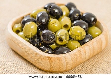 Olives - Bowl of pitted black and green olives. - stock photo