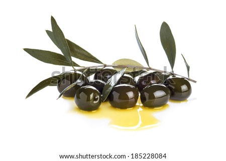 Olives covered in olive oil isolated on a white background - stock photo