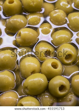 Olives in water, in a close up