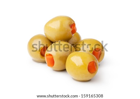 olives into bowls on wooden table