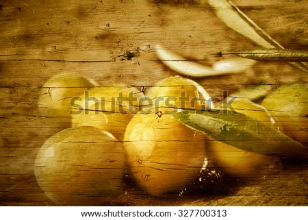 Olives marinated with olive oil on an old wooden texture background