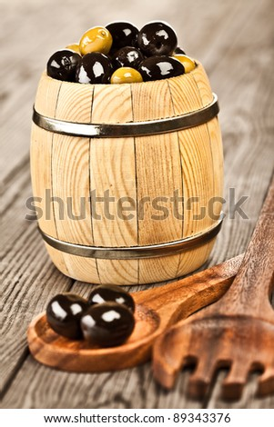 Olives on a wooden table ... - stock photo