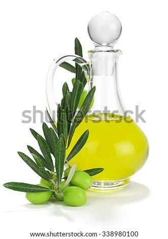 Olives on branch with leaves in front of bottle of olive oil isolated white background.     - stock photo